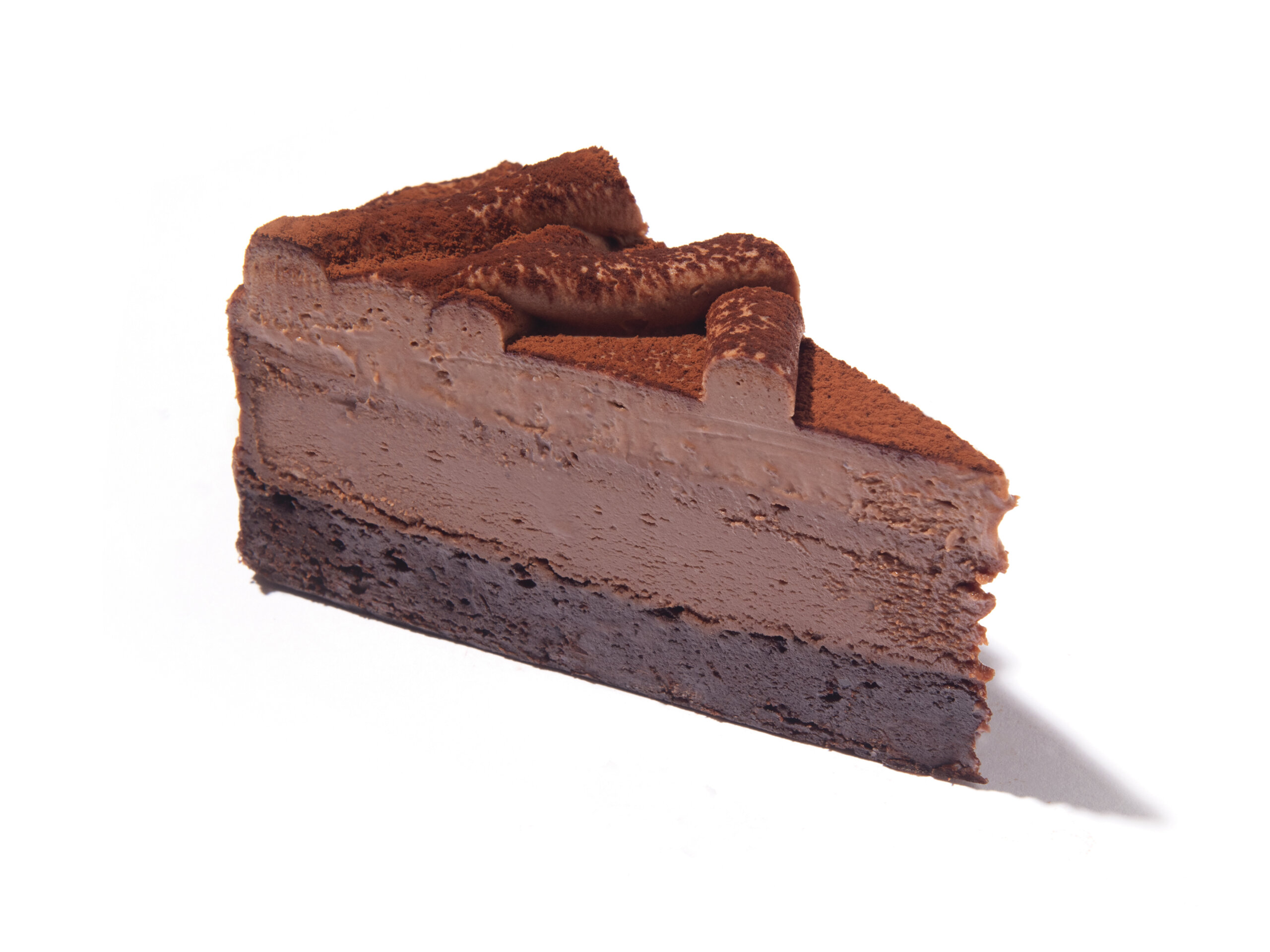 A slice of Eli's Double Chocolate Cheesecake made with Ghirardelli