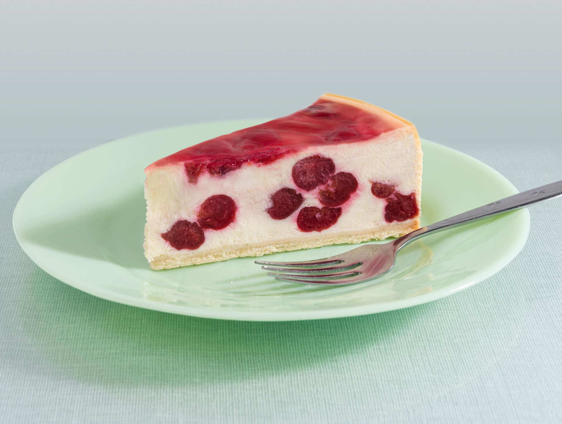 A lice of Eli's Cherry Vanilla Cheesecake